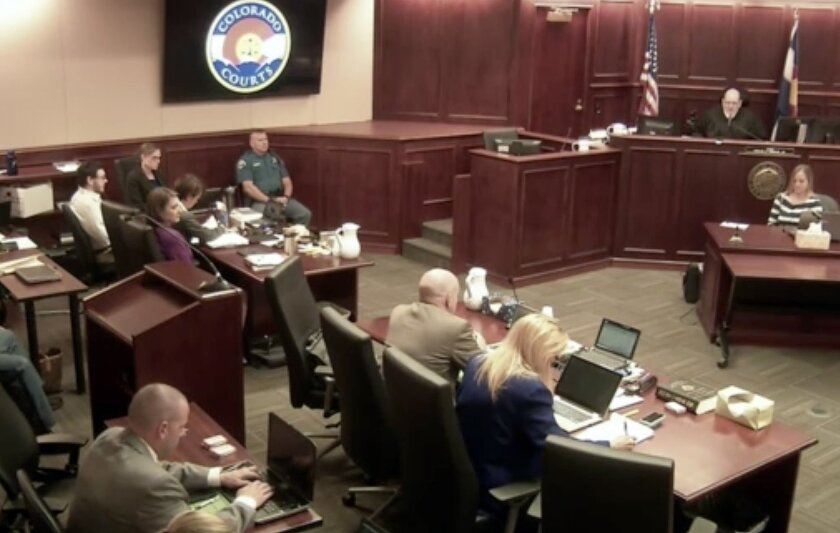 Colorado theater shooter James Holmes, top left in light-colored shirt, sits in Arapahoe County District Court, where his trial continues Thursday in Centennial, Colo.