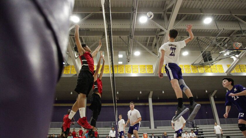 St. Augustine's Corbitt Kerr jumps to spike a shot against Hoover in the third period.