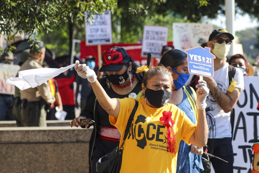 Tenants and housing rights organizers rally at Stanley Mosk Courthouse in Los Angeles to protest eviction orders on Sept. 2