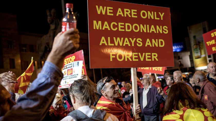 Supporters of the movement to boycott the referendum vote celebrate in the streets of Skopje, Macedonia, after election officials announced low voter turn out figures on Sunday.