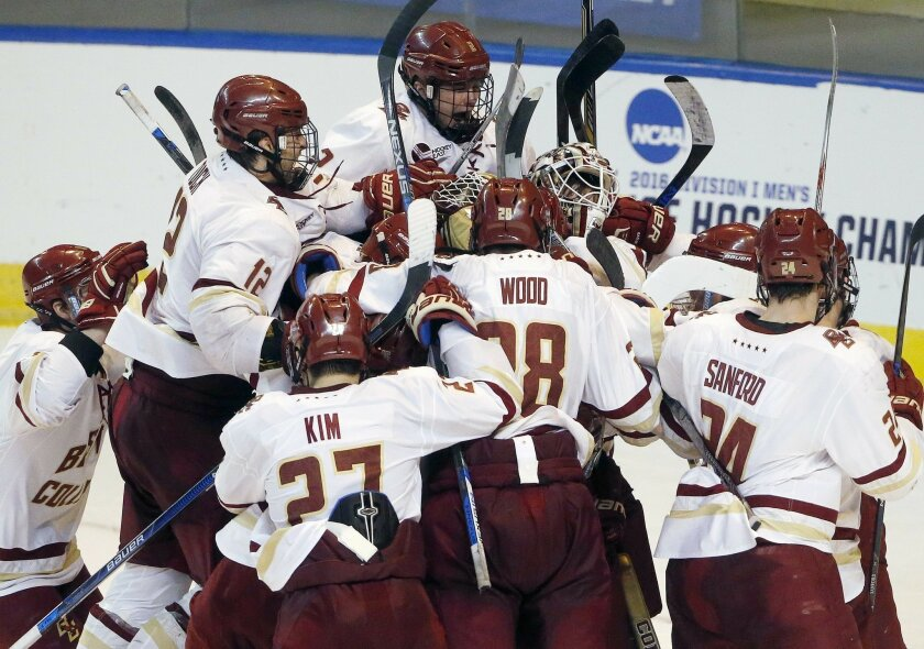 Boston College players celebrate after defeating Minnesota-Duluth 3-2 in the NCAA men's northeast regional championship hockey game in Worcester, Mass., Saturday, March 26, 2016. (AP Photo/Michael Dwyer)