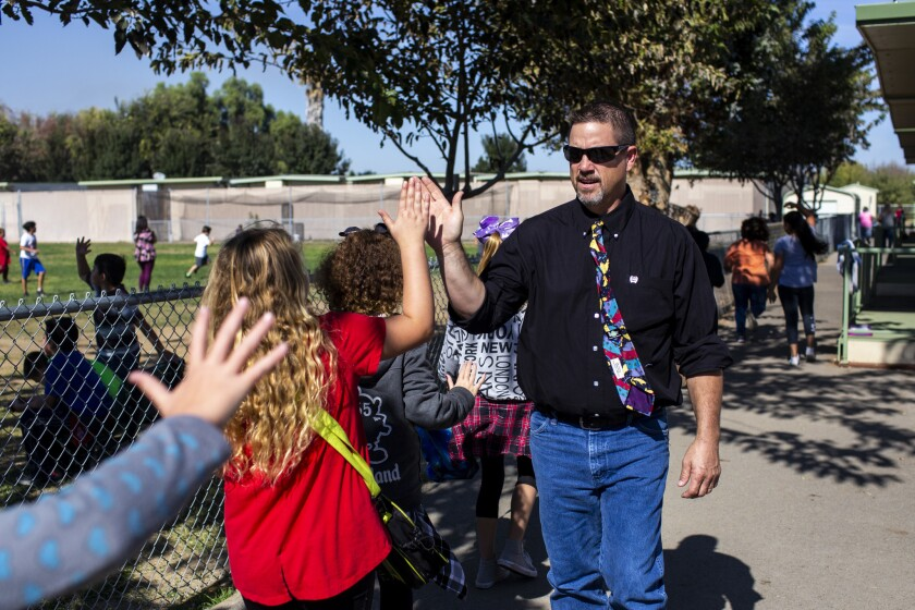 TRACY, CALIF. - OCTOBER 24: New Jerusalem School district superintendent David Thoming is greeted by