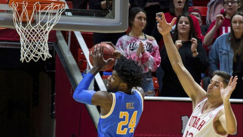 UCLA guard Jalen Hill (24) grabs a rebound against Utah forward Novak Topalovic (13) in the first half.