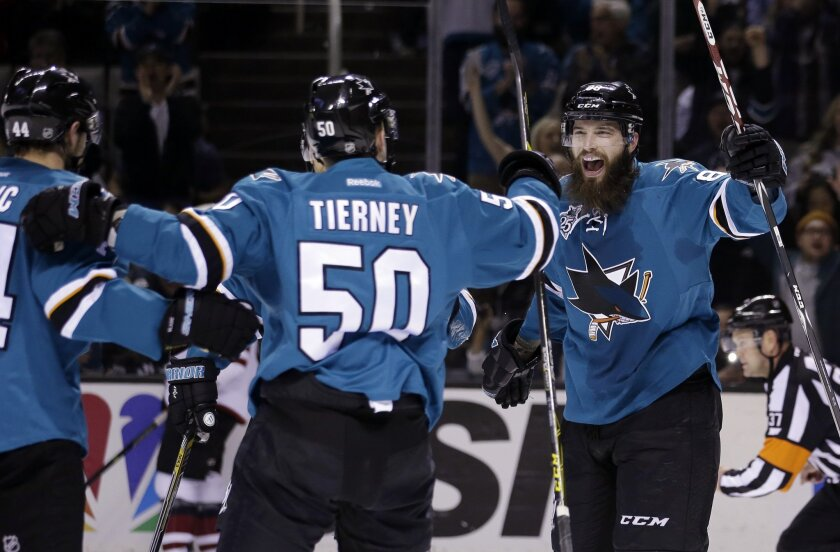 San Jose Sharks center Chris Tierney (50) celebrates his goal with teammate Brent Burns, right, during the first period of an NHL hockey game against the Arizona Coyotes on Saturday, Feb. 13, 2016, in San Jose, Calif. (AP Photo/Marcio Jose Sanchez)