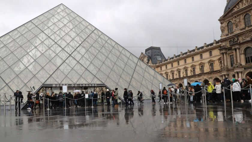 The Louvre Museum reopens on Feb. 4, 2017, a day after a machete-wielding attacker lunged at soldiers who were guarding the entrance.