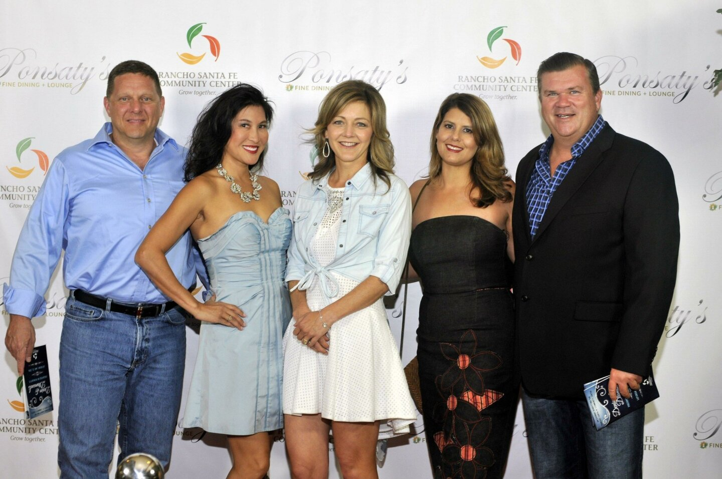 Eric Carlson, Cami Rosso, board member Krista Young, Jenna and Rob Albert
