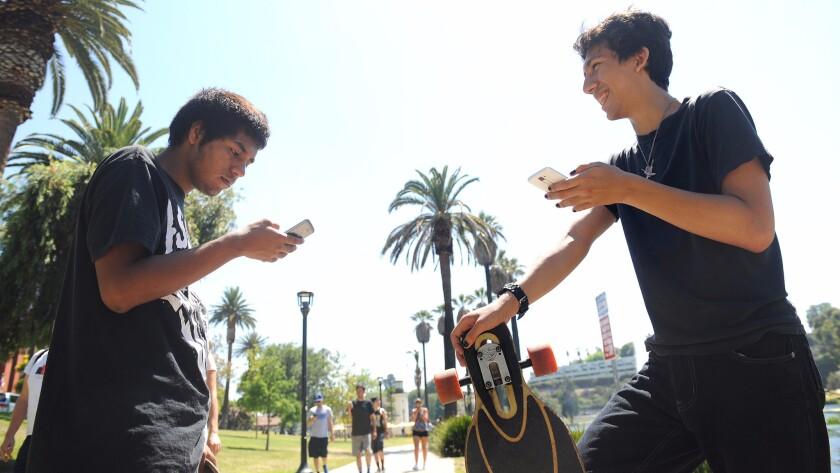 Pokemon Go players interact near Echo Park Lake on Wednesday, July 13.