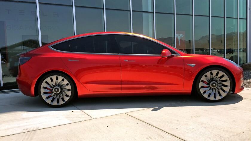 A Tesla Model 3 mockup shown Tuesday, July 26, 2016.
