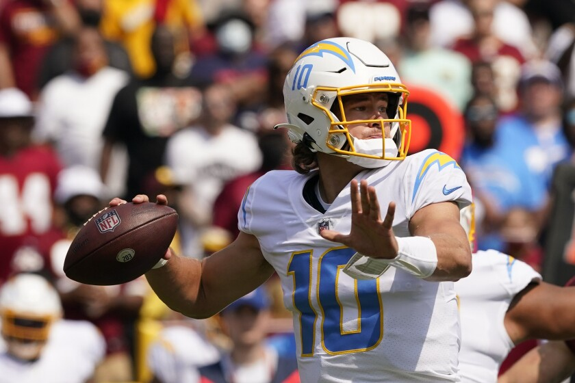 Los Angeles Chargers quarterback Justin Herbert (10) throws a pass against the Washington Football Team during the first half of an NFL football game, Sunday, Sept. 12, 2021, in Landover, Md. (AP Photo/Andrew Harnik)