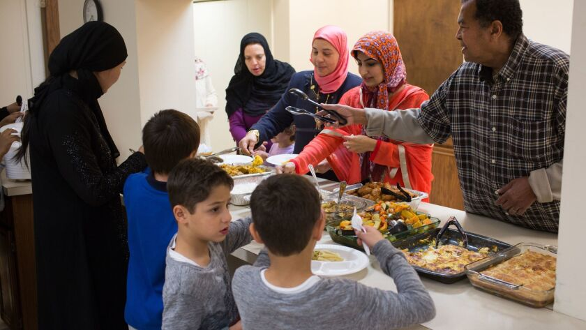 Food is served during a potluck and discussion at the Islamic Center of Cedar Rapids on Nov. 12, 20