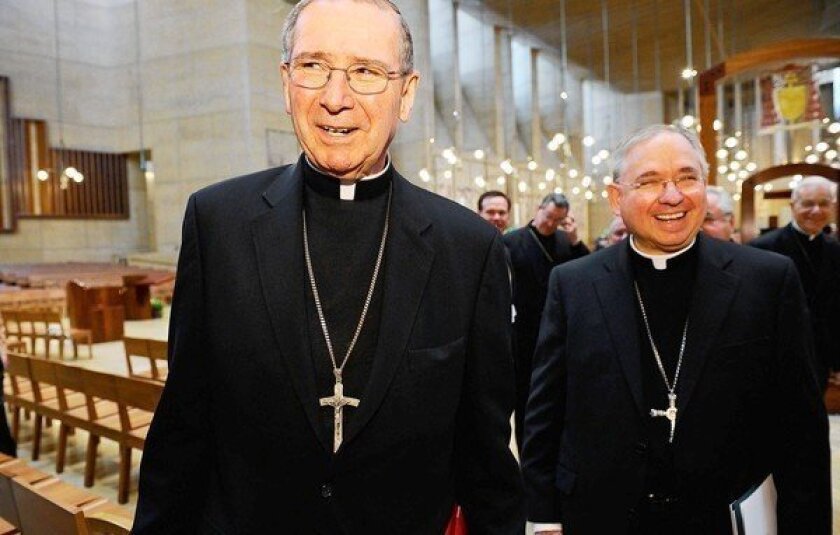 Cardinal Roger Mahony, left, with his successor, Jose Gomez, after a news conference at the Cathedral of Our Lady of the Angels on April 6, 2010.