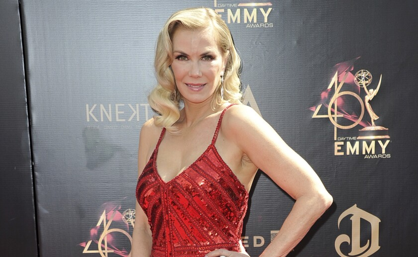"""FILE - In this May 5, 2019 file photo, Katherine Kelly Lang arrives at the 46th annual Daytime Emmy Awards in Pasadena, Calif. """"The Bold and the Beautiful"""" plans to resume production Wednesday, becoming the first network scripted show to start shooting again after the long coronavirus layoff. Lang, a longtime star of the show, said on Instagram that she's """"so excited"""" to finally return to work. (Photo by Richard Shotwell/Invision/AP, File)"""