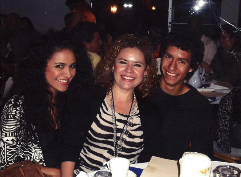 Ivan Ortiz, who died in a San Diego County jail, is pictured with his mother and  sister.