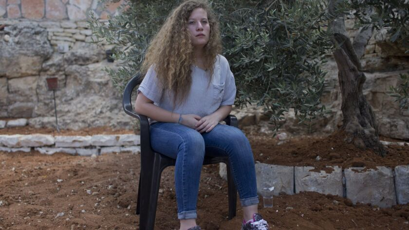 Ahed Tamimi sits July 30 in the backyard of her family house in the West Bank village of Nebi Saleh, near Ramallah.