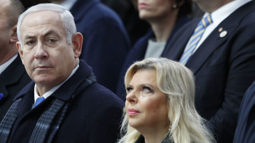Israeli Prime Minister Benjamin Netanyahu and his wife, Sara, attend ceremonies at the Arc de Triomphe in Paris on Nov. 11.