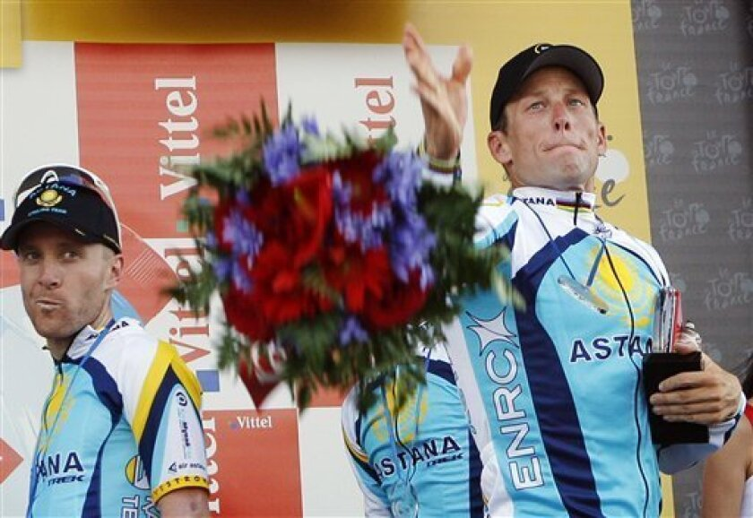 FILE - In this July 7, 2009, file photo, Lance Armstrong, right, and Levi Leipheimer, left, both of the United States, celebrate on the podium after winning the fourth stage of the Tour de France cycling race, a team time-trial with start and finish in Montpellier, southern France. In 2009, Armstro