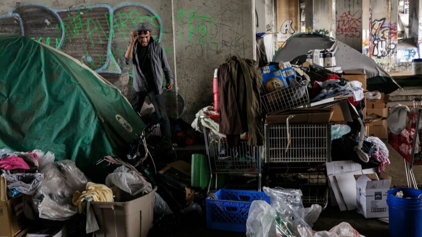 LOS ANGELES, CALIF. -- WEDNESDAY, MAY 31, 2017: Residents of a homeless encampment under the 1st str