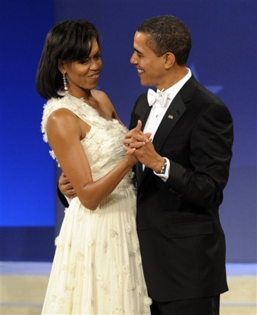 President Barack Obama and first lady Michelle Obama dance together at the Obama Home States Inaugural Ball in Washington, Tuesday, Jan. 20, 2009.  (AP Photo/Susan Walsh)