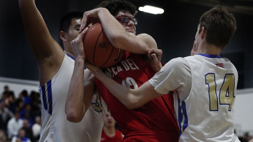 Mater Dei's Wilhelm Breidenbach is double teamed by Santa Margarita Shengzhe Li, left, and Jack McCloskey, right, during the first half at Santa Margarita High School on Wednesday.