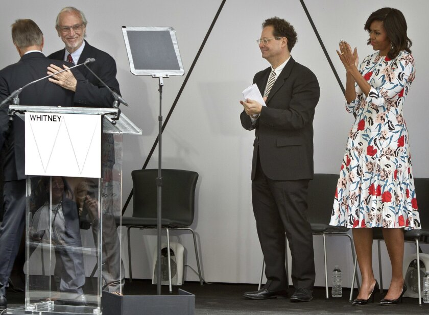 First lady Michelle Obama, far right, and Adam Weinberg, second from right, director of the Whitney Museum of Art, applaud as Renzo Piano, second from left, prepares to speak during a ribbon-cutting ceremony for the new $422 million Whitney Museum of American Art he designed, Thursday, April 30, 20