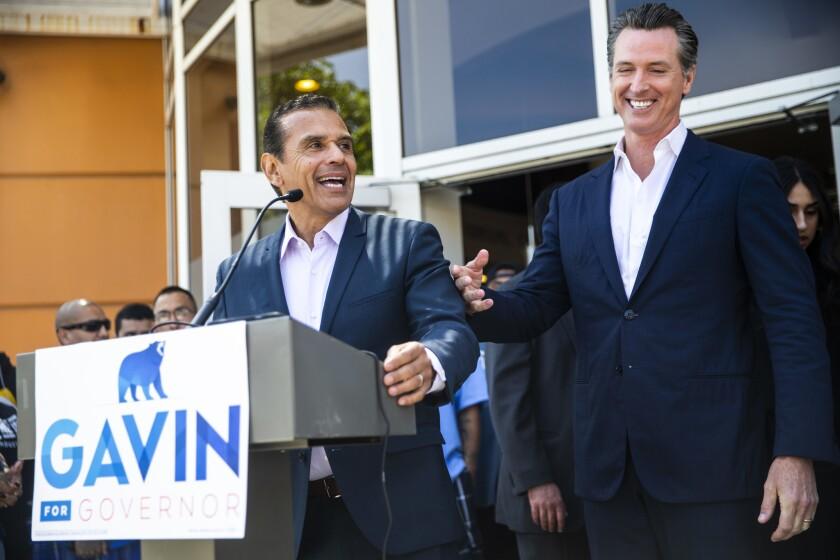 Former L.A. Mayor Antonio Villaraigosa, at the microphone, with then-Lt. Gov. Gavin Newsom, right, in 2018.