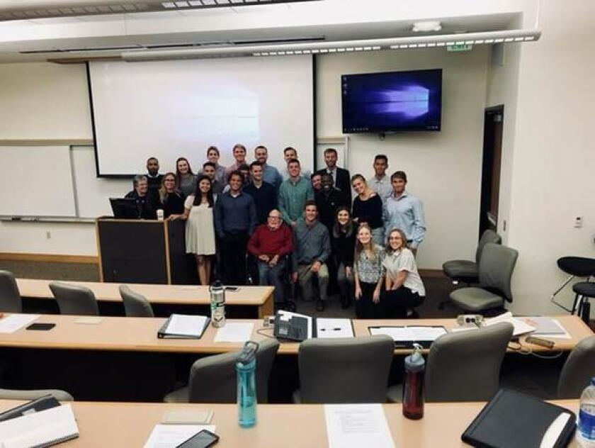 Famed oceanograper Walter Munk (center, front row) poses with Professor Madeline Scarpella's administrative communications class at Point Loma Nazarene University.