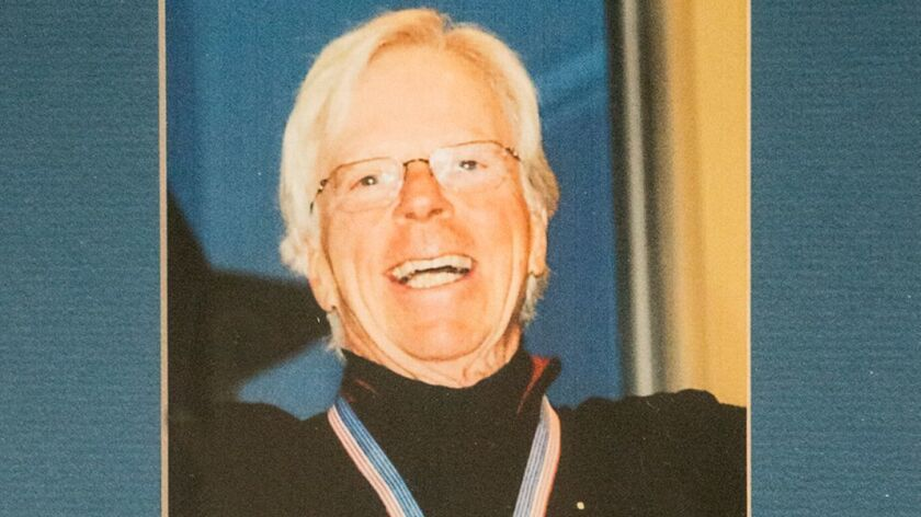 John Bloomberg (1935-2017) celebrates the gold medal he won in 2014 for ski racing