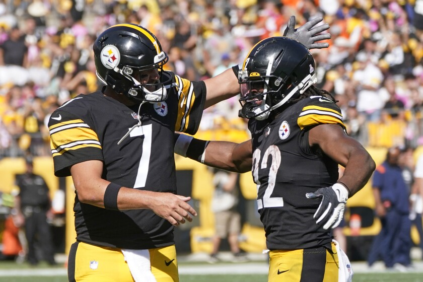 Pittsburgh Steelers running back Najee Harris (22) celebrates with quarterback Ben Roethlisberger after scoring during the first half of an NFL football game against the Denver Broncos in Pittsburgh, Sunday, Oct. 10, 2021. (AP Photo/Keith Srakocic)