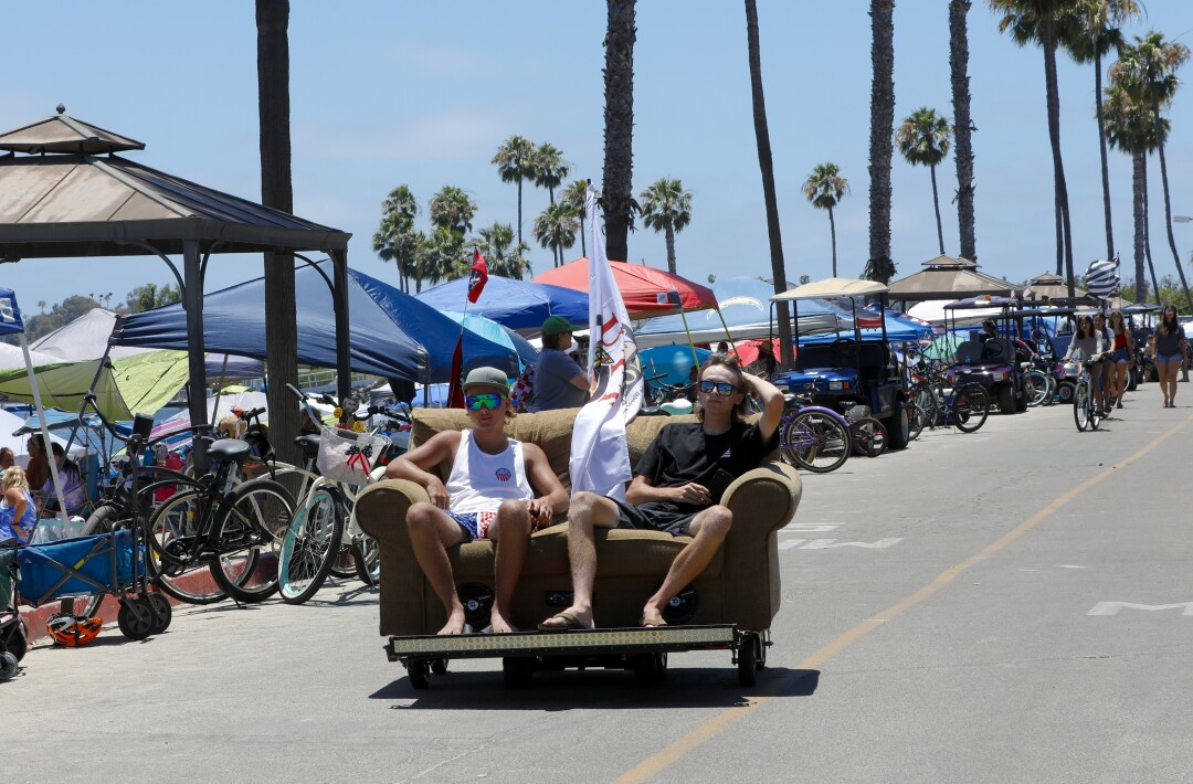 Christopher Easter from Mira Mesa and Payton Lesh from El Cajon cruise in a custom made driving couch that they built.