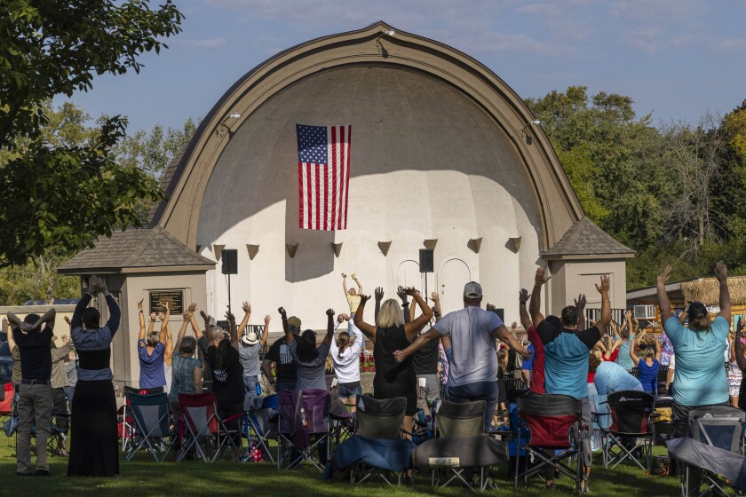 People listen to speakers at the Chiropractic Society Health Freedom revival Sept. 19 in Oconomowoc, Wis.