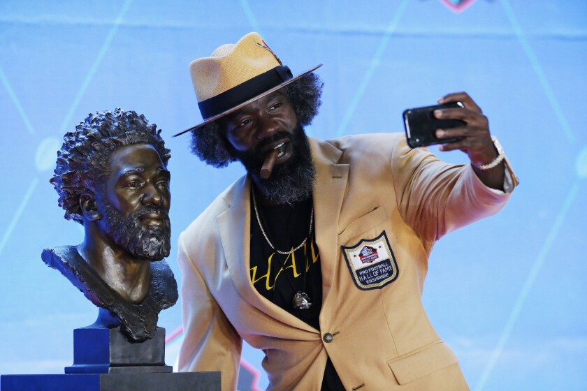 Former NFL great Ed Reed takes a selfie with his Pro Football Hall of Fame bust.