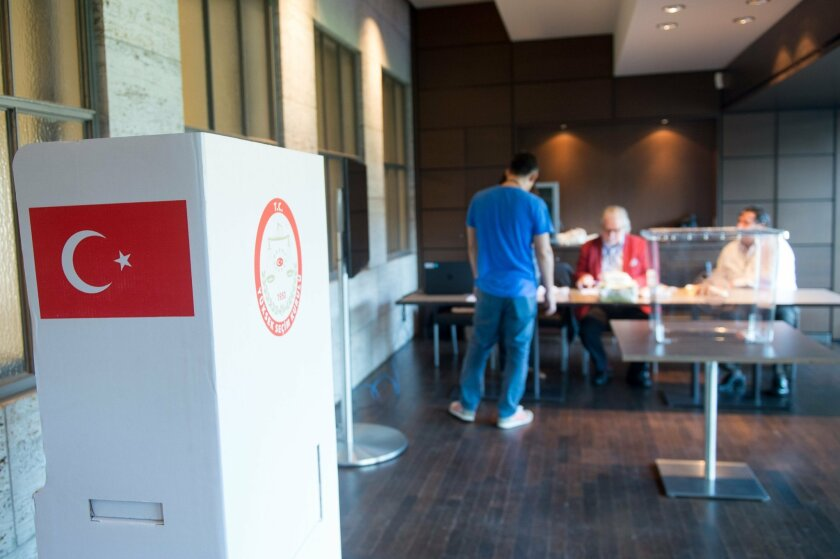 Election assistants prepare a polling station for the Turkish presidential elections at the Olympic Stadium in Berlin, Germany, Thursday, July 31, 2014.About 1.4 million Turkish immigrants in Germany were allowed to participate in the elections in their country of origin, even though many of those
