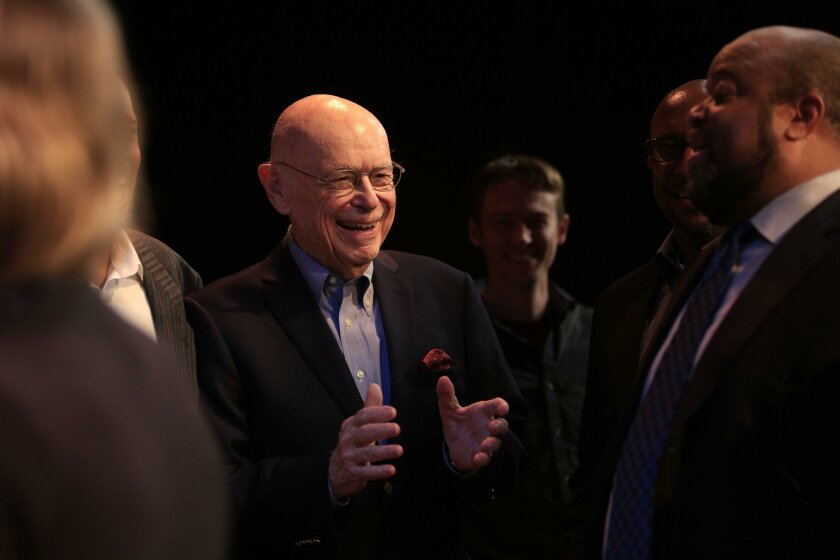 """Retired U.S. District Court Judge H. Lee Sarokin, now a playwright, talks with Mark Christopher Lawrence, right, who was among the actors featured in a reading of his play """"The Race Card Face Face Up"""" at North Coast Repertory Theatre on Monday evening."""