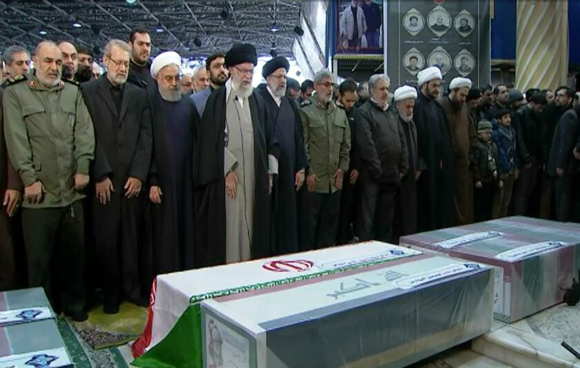 Iranian Supreme Leader Ayatollah Ali Khamenei leads a prayer over the coffins of Gen. Qassem Soleimani and his comrades, who were killed in Iraq in a U.S. drone strike.