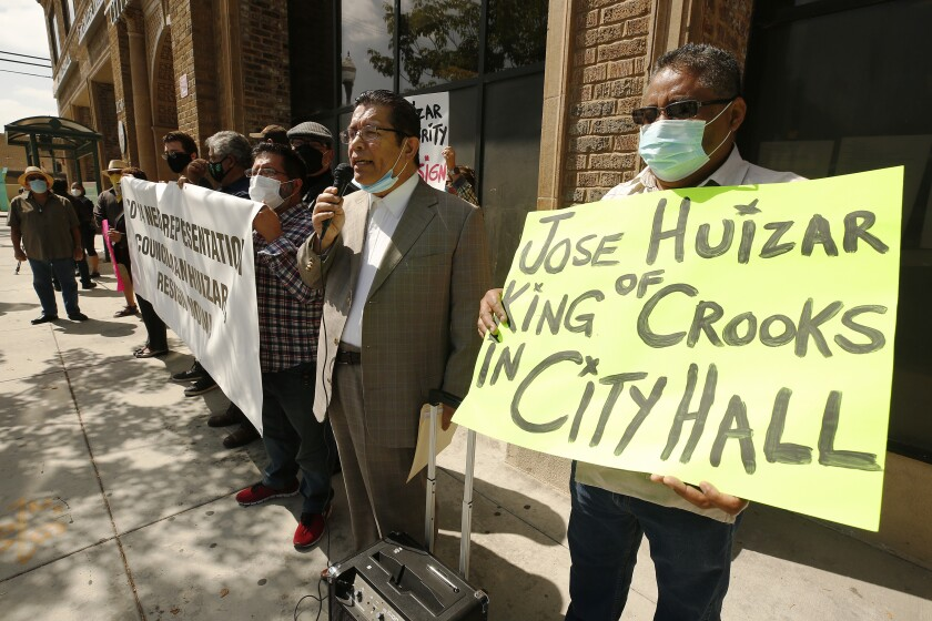 Immigrants rights activists protest outside Jose Huizar's City Council office