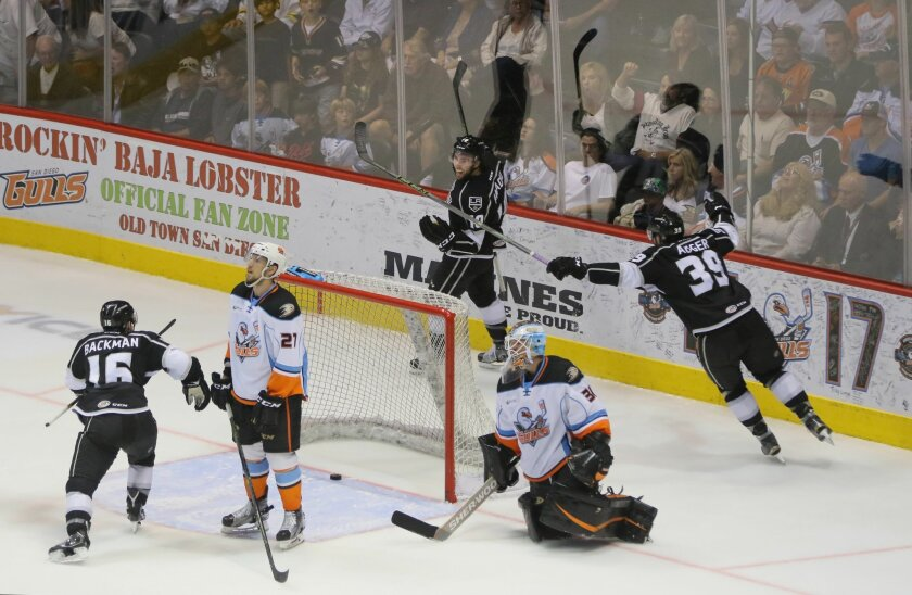 The Reign's Mike Amadio, middle above, celebrates his game winning goal in O.T. Gulls players below, Chris Wagner, left and goalkeeper Matt Hackett stare in disbelief.