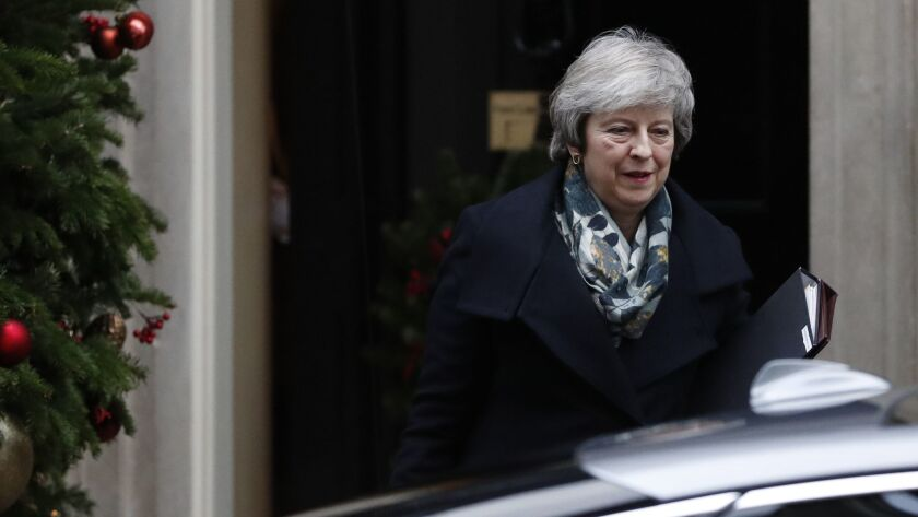 Britain's Prime Minister Theresa May leaves 10 Downing Street, in London Monday, Dec. 17, 2018, for