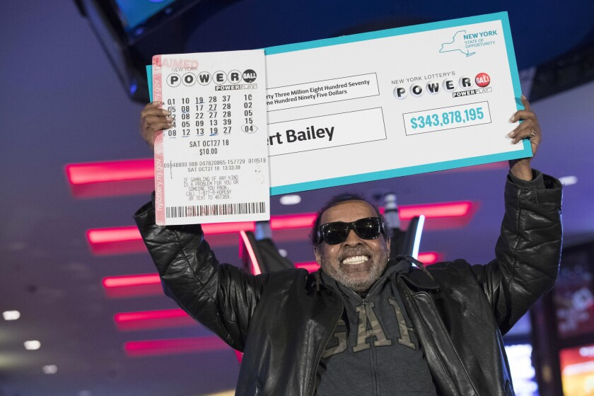 Robert Bailey poses for photographers during a news conference at the Resorts World Casino on Wednesday. The retired government worker won over $343 million in Powerball, the biggest jackpot in New York state lottery history.