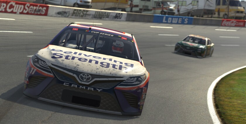Denny Hamlin, front, competes May 9, 2020, at virtual North Wilkesboro (N.C.) Speedway.