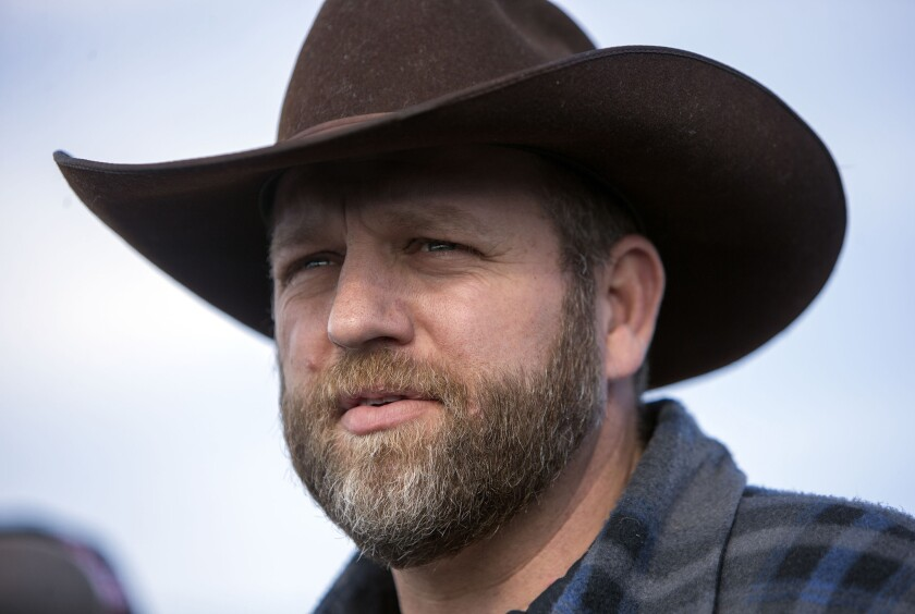 Ammon Bundy speaks at the top of the road leading to the headquarters of the Malheur National Wildlife Refuge on Jan. 6.