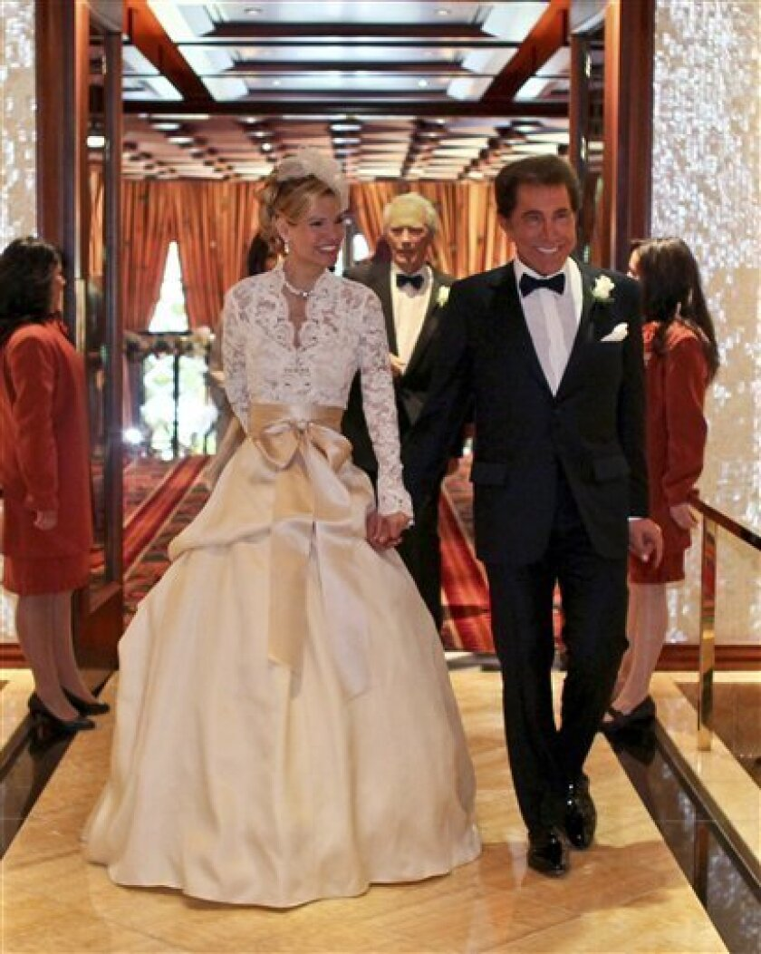 This photo provided by Wynn Resorts, Chairman of the Board and Chief Executive Officer of Wynn Resorts, Limited, Stephen A. Wynn and Ms. Andrea Hissom are shown after their wedding ceremony on Saturday, April 30, 2011 in Las Vegas. on April 30 in a private ceremony. Wynn married his fiancée Andrea Hissom at a private gathering of 500 friends and family at Wynn Las Vegas. Wynn Resorts confirmed the two had wed and ``celebrated their nuptials'' at the resort on the Las Vegas Strip in a statement released just before 5:30 p.m. Saturday but declined to provide any details. (AP Photo/Wynn Resorts, Brittany Hanson)