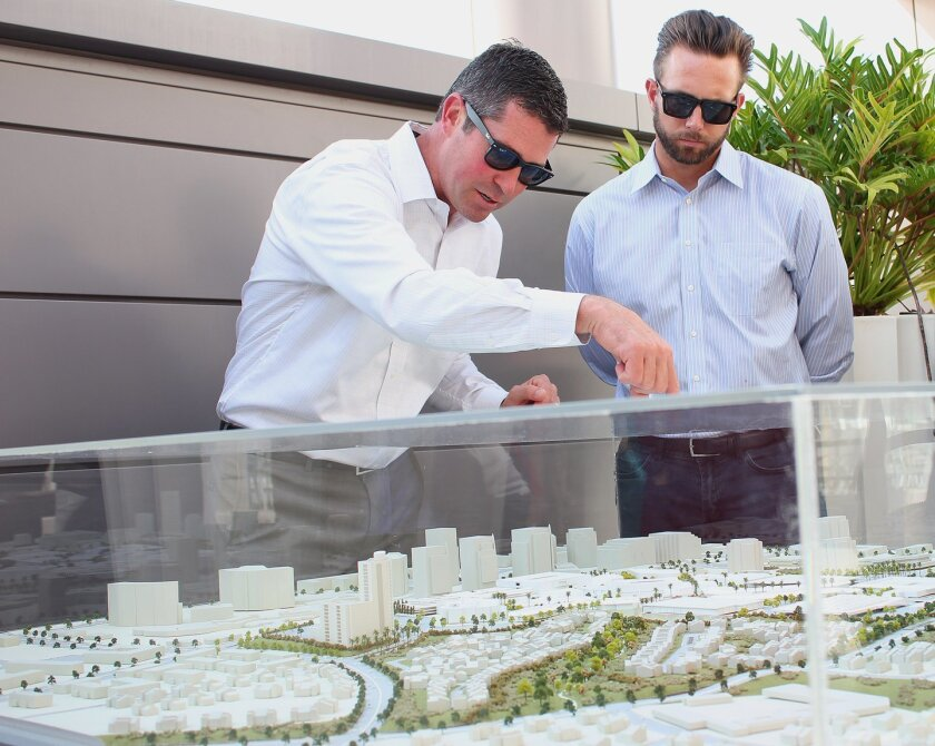 Standing over a scaled-down model of Westfield UTC shopping mall, senior general manager Ryan Perry (left) explains what's to come with the expansion, at a preview event, October 2015.