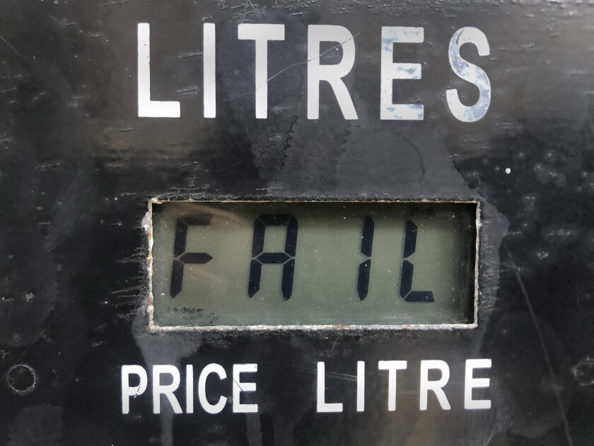 """A screen on a gasoline pump reads, """"Fail,"""" after the latest increase in fuel prices with most meters unable to accommodate the new five digit price for one liter of gas, in Beirut, Lebanon, Wednesday, Sept. 22, 2021. The technical problem forced most gas stations to shut down, despite the long queues of vehicles waiting to fill up their tanks. Lebanon's new government raised the price of fuel on Wednesday by 16%, the second time in five days, part of a gradual lifting of subsidies in the crisis-struck country. (AP Photo/Hussein Malla)"""