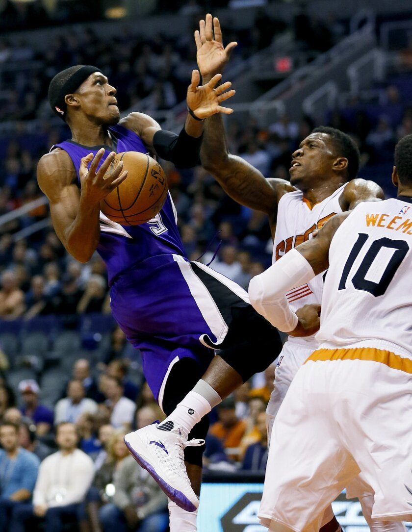 Sacramento Kings' Rajon Rondo drives against Phoenix Suns' Eric Bledsoe, right, during the first half of an NBA basketball game, Wednesday, Nov. 4, 2015, in Phoenix. (AP Photo/Matt York)