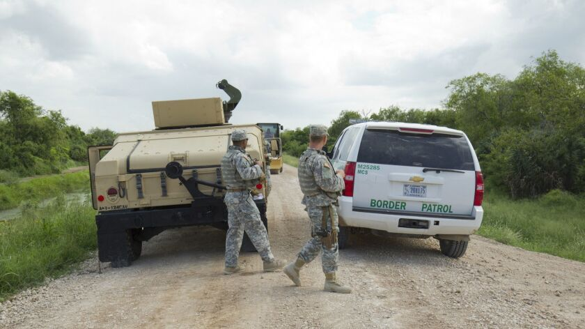 National Guard troops do a shift change on the Rio Grande levee near Anzalduas Park in Granjeno, Texas.