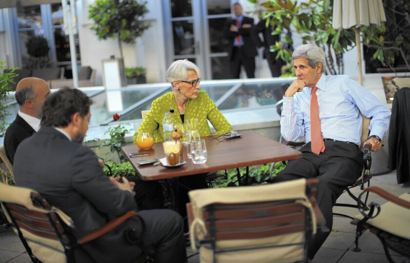 Secretary of State John F. Kerry, right, meets with chief U.S. negotiator Wendy Sherman and other U.S. officials at the hotel in Vienna where the Iran nuclear talks are being held.