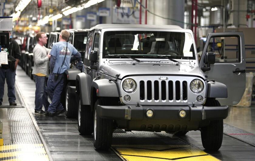 Jeep Wranglers prepare to come off the line after undergoing assembly at the Chrysler Toledo North Assembly Plant in Toledo, Ohio. Fiat Chrysler Automobiles announced it wants to turn Jeep into a global brand as part of an aggressive five-year plan.