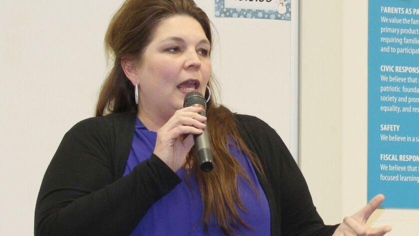 Principal Pauline Leavitt presents Olive Peirce Middle School's math program to district trustees.