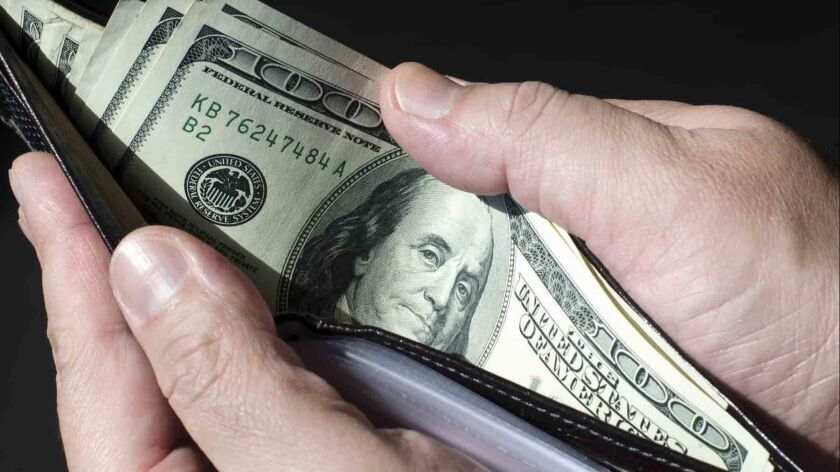 Wallet full of money, concept of wealth.
