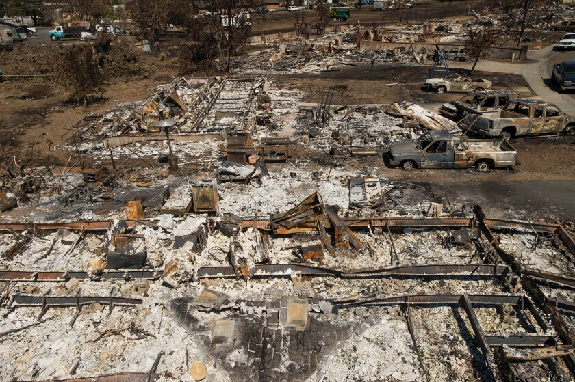 Destroyed homes and vehicles scorched by the Valley fire line Jefferson Street in Middletown, Calif, on Monday, Sept. 21, 2015.